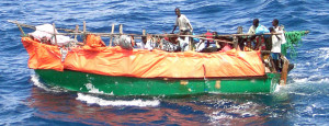 050429-N-5526M-001 (Apr. 29, 2005) Crew members assigned to the US Navy (USN) Cyclone Class Coastal Defense Ship USS FIREBOLT (PC 10) rescue refugees from Somalia after their boat, a fishing Dowel, capsized somewhere out in the Indian Ocean (IOC).  The FIREBOLT is currently providing Maritime Security Operations (MSO) in support of Operation ENDURING FREEDOM. U.S. Navy official photo by Photographer's Mate First Class Robert R. McRill (RELEASED)
